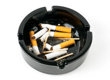 Ashtray. With butts and matches over white Stock Photo