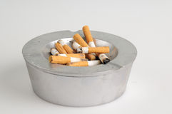 Ashtray. With many smoked cigarettes in it Stock Photos
