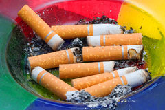 Ashtray. An ashtray full of old cigarette butts royalty free stock images