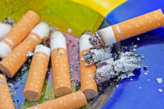 Ashtray. An ashtray full of old cigarette butts stock photo