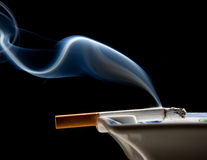 Ashtray And Smoke Wisp Stock Image