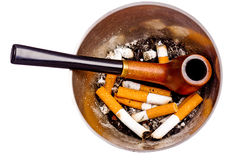 Ashtray with butts and pipe Stock Photography