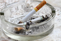 Ashtray and cigarette Stock Images