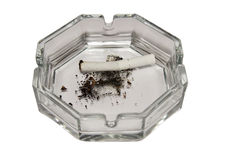 Ashtray. Cigarette in an ashtray royalty free stock images
