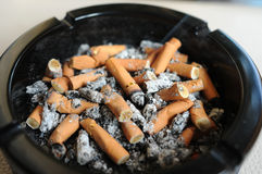 Ashtray with cigarette butts Royalty Free Stock Images