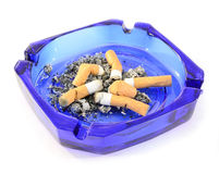 Ashtray with cigarette butts. Blue ashtray with cigarette butts isolated on white background Stock Photo