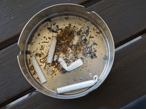 Ashtray with cigarette butts Royalty Free Stock Photos