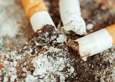 Ashtray with cigarette butts Royalty Free Stock Photo