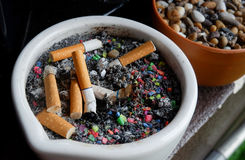 Ashtray cigarette. Ashtray full of spent cigarette butts Stock Photography