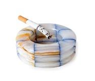 Ashtray and cigarette Stock Photo