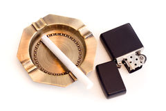 Ashtray and cigarette lighter. On a white background Royalty Free Stock Photos