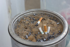 Ashtray with Cigarette. Sand ashtray with Cigarette, stop smoking Royalty Free Stock Images
