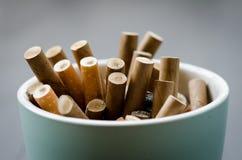 Ashtray close-up. Ashtray full of cigarettes used Royalty Free Stock Image