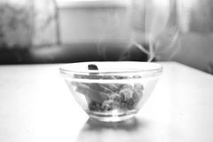 Ashtray filled with smoldering cigarette Royalty Free Stock Photo