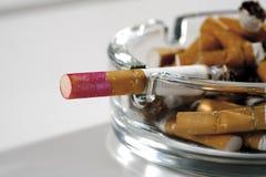 Ashtray full of burnt cigarettes Stock Image