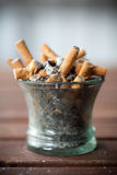 Ashtray full with butts Royalty Free Stock Image