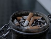 An ashtray full of cigarette butt. royalty free stock photography