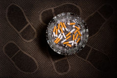 Ashtray full of cigarette butts Stock Photo