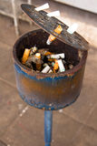 Ashtray full of cigarette butts Royalty Free Stock Photo