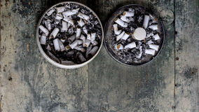 Ashtray full of cigarettes. Ashtray with loads of cigarettes in it, addictive drugs Royalty Free Stock Photo