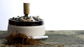 Ashtray full of cigarettes. Ashtray with loads of cigarettes in it, addictive drugs Stock Photography