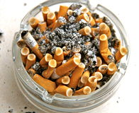 Ashtray full off cigarettes Stock Photos