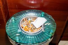 The ashtray. Ashtray full of spent cigarette butts Royalty Free Stock Photos