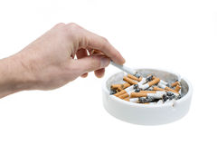 Ashtray hand and cigarettes Royalty Free Stock Photo