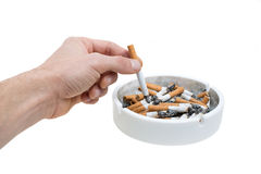Ashtray hand and cigarettes Royalty Free Stock Images
