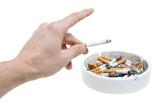 Ashtray hand and cigarettes Stock Images