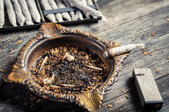 Ashtray and handmade cigarettes Stock Photography