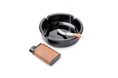 Ashtray, lighter and a cigarette Stock Photos