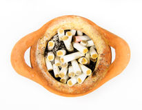 Ashtray with a lot of cigarette butts isolated Stock Image