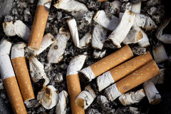 Cigarette. Ashtray with many cigarette butts Royalty Free Stock Photo