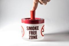 Ashtray with message, smoke free zone. Ashtray with message, smoke free zone and finger of man stock photos