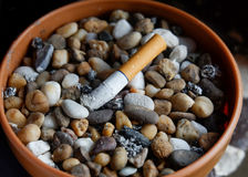 Ashtray. With Pebbles And cigarettes Stock Image