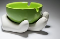 Ashtray Souvenir. Cool looking, hand-made ashtray souvenir against a gradient black and white background. The soft light brings up the realistic looks, while at stock photos