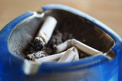 Ashtray with stump of cigarettes Stock Photo
