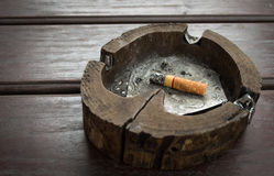 Ashtray on the table. Cancer cigarette closeup danger death Royalty Free Stock Images