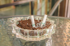 Ashtray on the table Royalty Free Stock Image