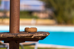 Ashtray on a table under a parasol on the beach. Ashtray on a table under a parasol Stock Photography