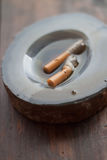Ashtray. With two cigarette in the water Royalty Free Stock Photo