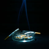Ashtray and two Cigarettes Royalty Free Stock Image