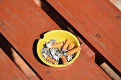 Ashtray on wood board Royalty Free Stock Photos