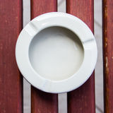 Ashtray. On wooden table Royalty Free Stock Photography