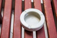 Ashtray. On wooden table Royalty Free Stock Photos