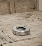 Ashtray on a wooden table. Empty stainless ashtray on a wooden table Stock Photo