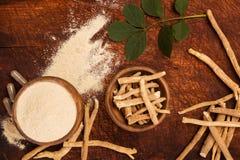 Ashwagandha superfood powder and root. Stock Image