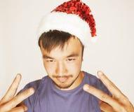 Asiático exótico Papá Noel de Funy en Años Nuevos rojos Fotos de archivo
