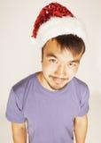 Asiático exótico Papá Noel de Funy en Años Nuevos rojos Foto de archivo